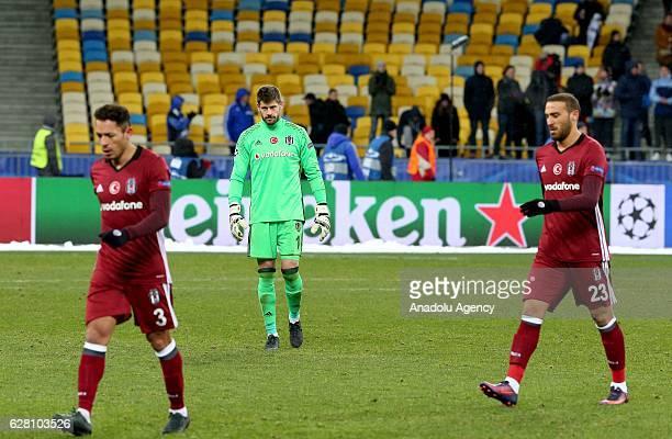 Fabricio Adriano and Cenk Tosun of Besiktas JK get upset after the UEFA Champions League football match between FC Dynamo Kiev and Besiktas JK at the...
