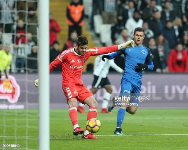 Fabricio Agosto Ramirez of Besiktas in action against Strahil Popov of Kasimpasa during the Turkish Super Lig match between Besiktas and Kasimpasa at...