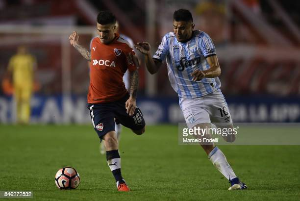 Fabricio Bustos of Independiente fights for ball with Gervasio Nuñez of Atletico Tucuman during a second leg match between Independiente and Atletico...