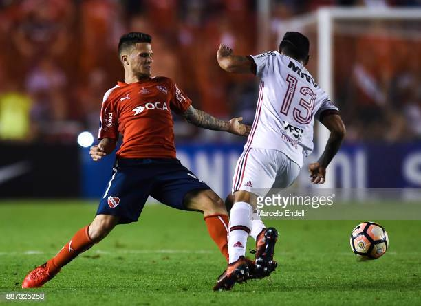 Fabricio Bustos of Independiente fights for ball with Miguel Trauco of Flamengo during the first leg of the Copa Sudamericana 2017 final between...