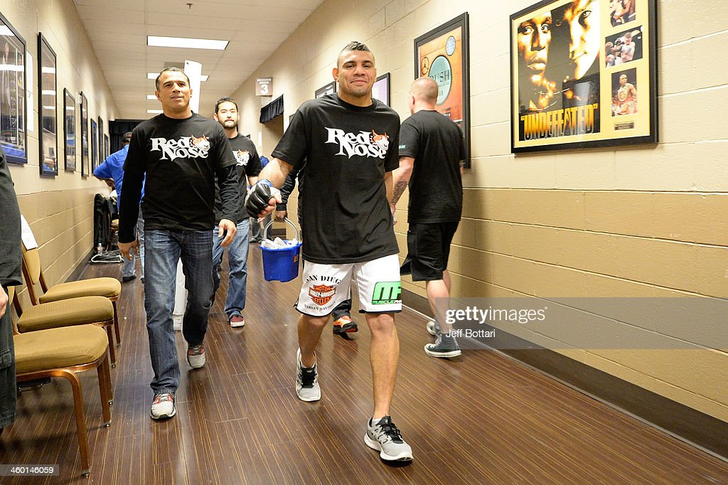 Fabricio Camoes walks out of the locker room before facing Jim Miller in their lightweight bout during the UFC 168 event at the MGM Grand Garden Arena on December 28, 2013 in Las Vegas, Nevada.