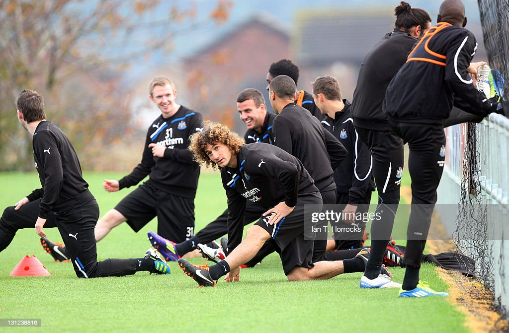 Fabricio Coloccini (C) limbers up with team mates during a Newcastle United Training session at The Little Benton Training Ground on November 03, 2011 in Newcastle, United Kingdom.