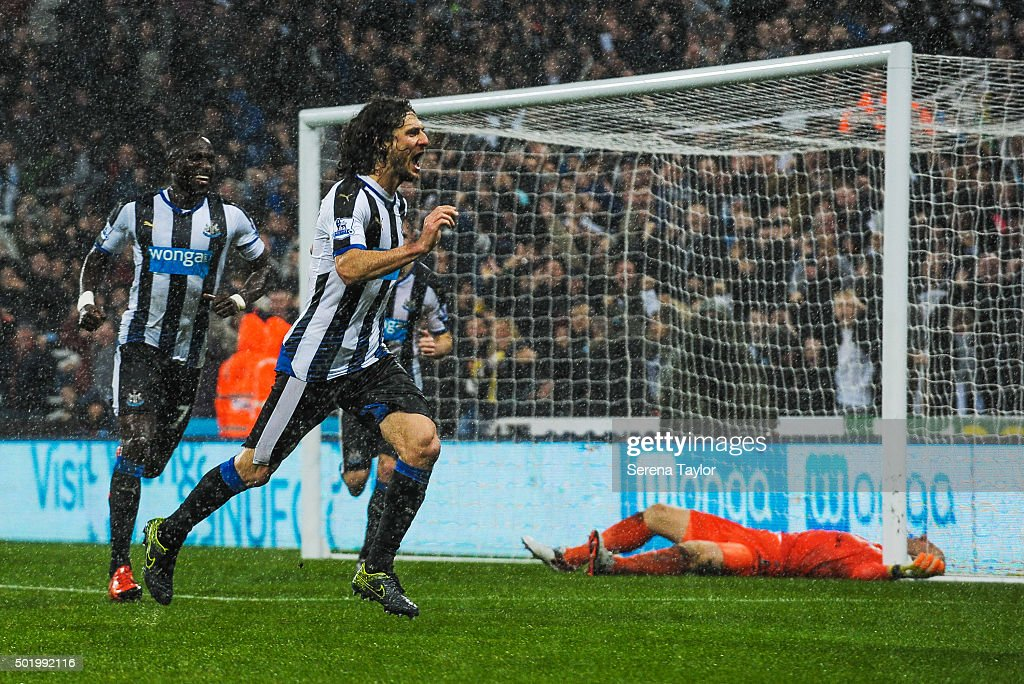 Fabricio Coloccini (C) of Newcastle celebrates after scoring the opening goal during the Barclays Premier League match between Newcastle United and Aston Villa at St.James' Park on December 19, 2015, in Newcastle upon Tyne, England.