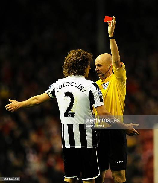 Fabricio Coloccini of Newcastle gets shown the red card by referee Anthony Taylor during the Barclays Premier League match between Liverpool and...