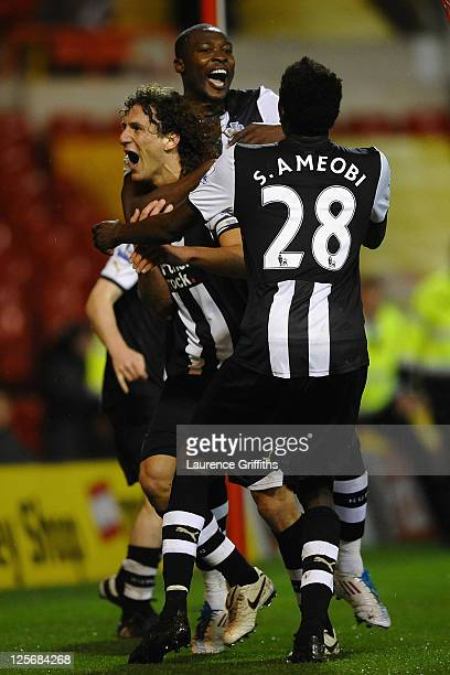 Fabricio Coloccini of Newcastle United celebrates scoring the winning goal in extra time with team mates Shola Ameobi and Sammy Ameobi during the...