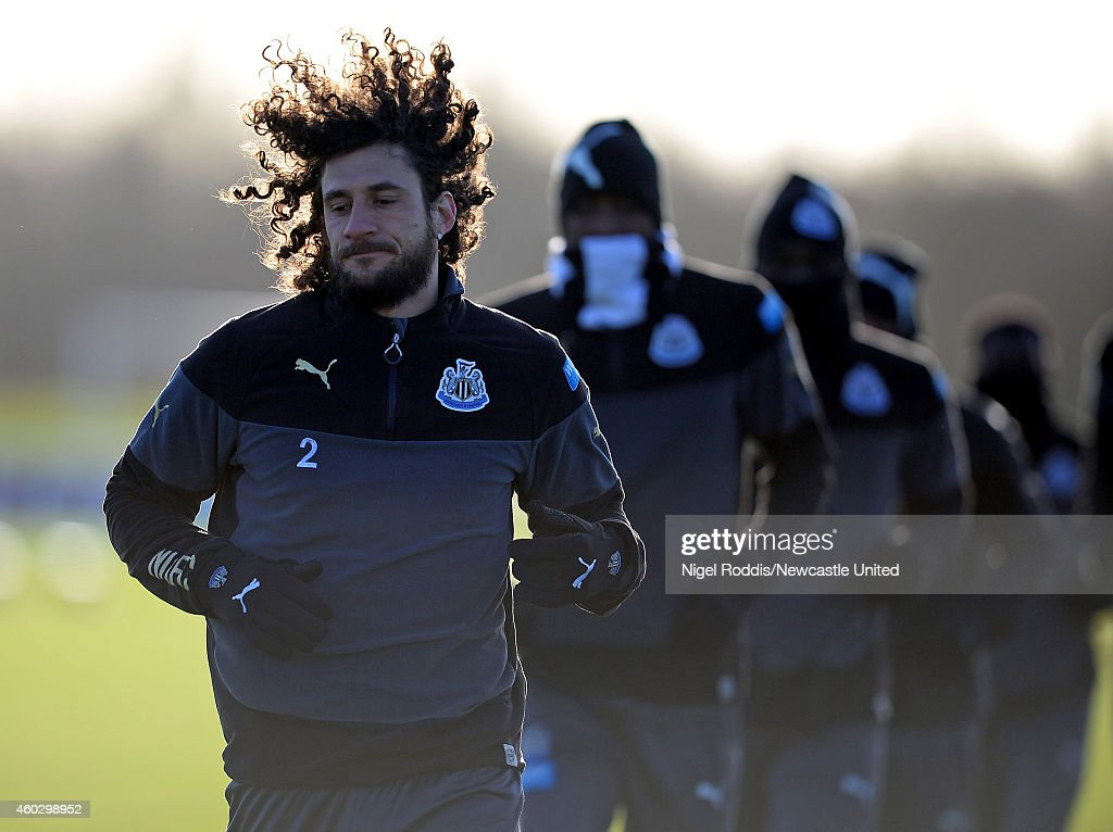 Fabricio Coloccini (L) of Newcastle United during a training session at The Newcastle United Training Centre on December 11, 2014 in Newcastle upon Tyne, England.