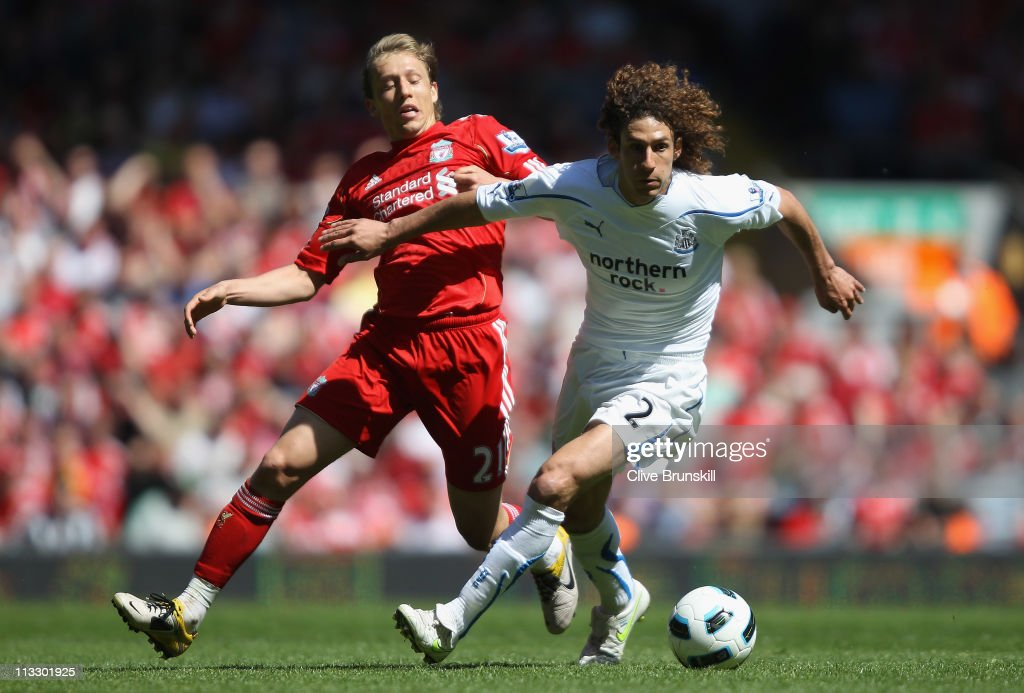 Fabricio Coloccini of Newcastle United holds off Lucas of Liverpool during the Barclays Premier League match between Liverpool and Newcastle United at Anfield on May 1, 2011 in Liverpool, England.