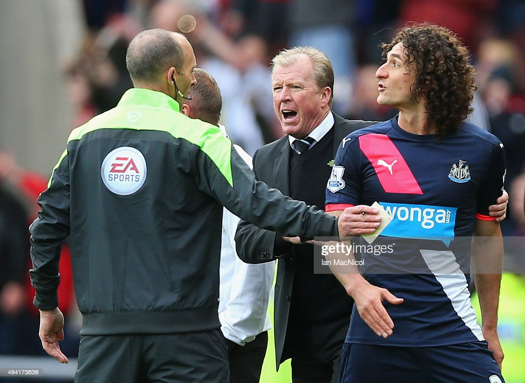 Fabricio Coloccini of Newcastle United leaves the pitch after being sent off while Steve McClaren manager of Newcastle United argues with the fourth official during the Barclays Premier League match between Sunderland and Newcastle United at Stadium of Light on October 25, 2015 in Sunderland, England.