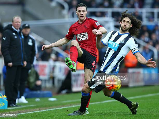 Fabricio Coloccini of Newcastle United tackles James Chester of West Bromwich Albion during the Barclays Premier League match between Newcastle...
