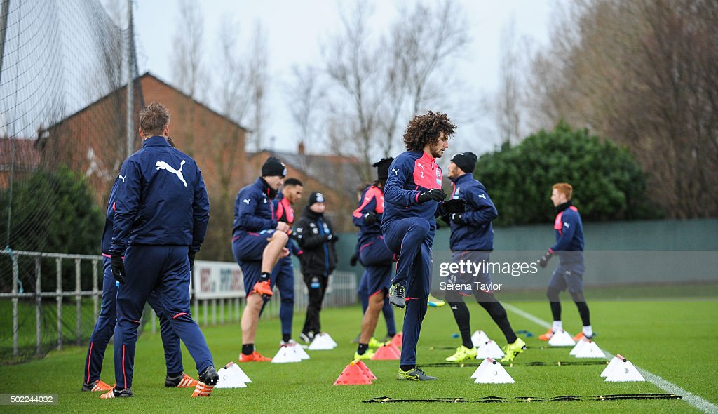 Fabricio Coloccini (C) warms up during the Newcastle United Training session at The Newcastle United Training Centre on December 22, 2015, in Newcastle upon Tyne, England.