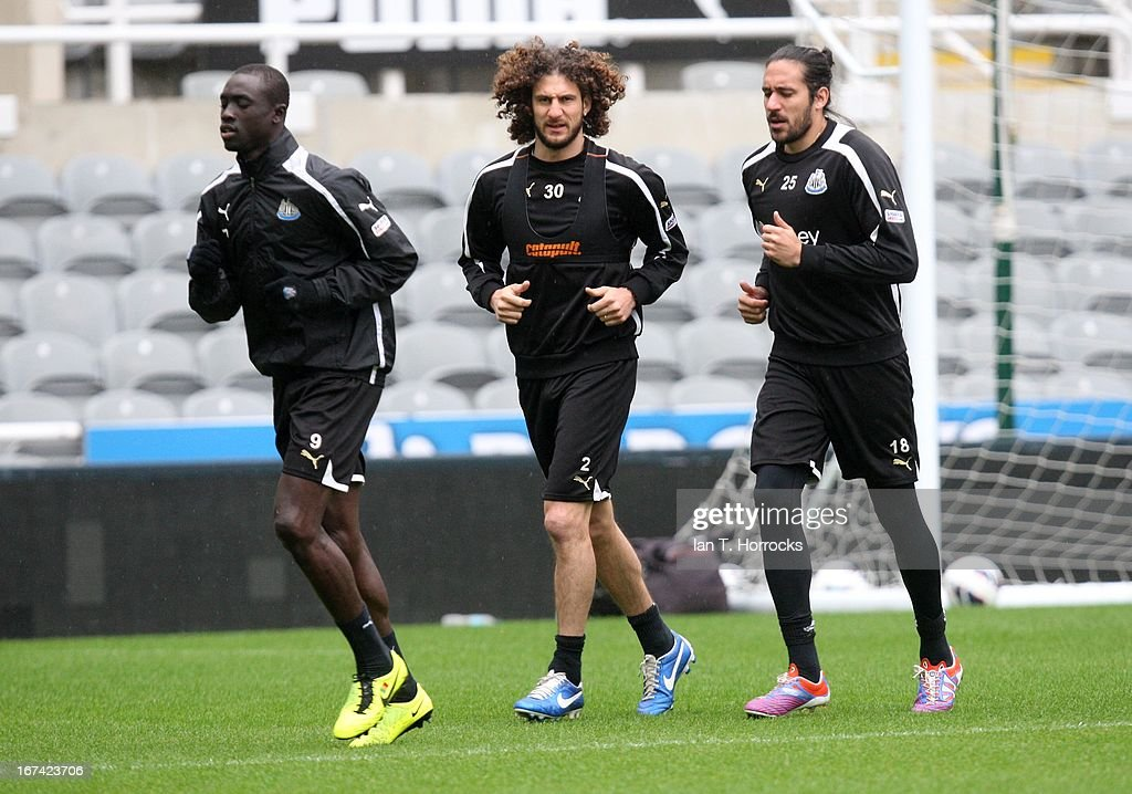 Fabricio Coloccini (center) with Jonas Gutierrez (right) and Papis Cisse during a Newcastle United training session at St James' Park on April 25, in Newcastle upon Tyne, England.
