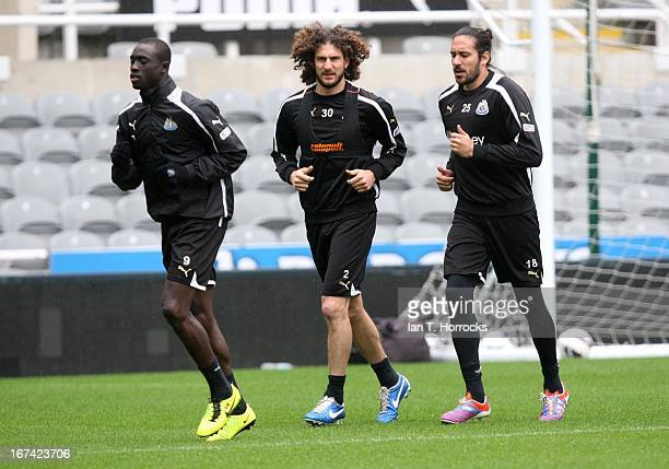 Fabricio Coloccini with Jonas Gutierrez and Papis Cisse during a Newcastle United training session at St James' Park on April 25 in Newcastle upon...