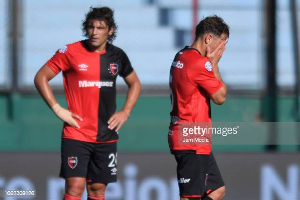 Fabricio Fontanini and Hernan Bernardello of Newell's react after losing a Quarter Final match between Newell's Old Boys and Rosario Central as part...