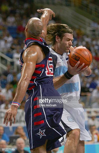 Fabricio Oberto of Argentina goes to the basket against Richard Jefferson of United States in the first half of the men's basketball semifinal game...