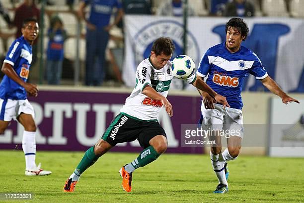 Fabricio , of Cruzeiro, struggles for the ball with Everton Ribeiro , of Coritiba, during a match as part of Brazilian Championship Serie A at Arena...
