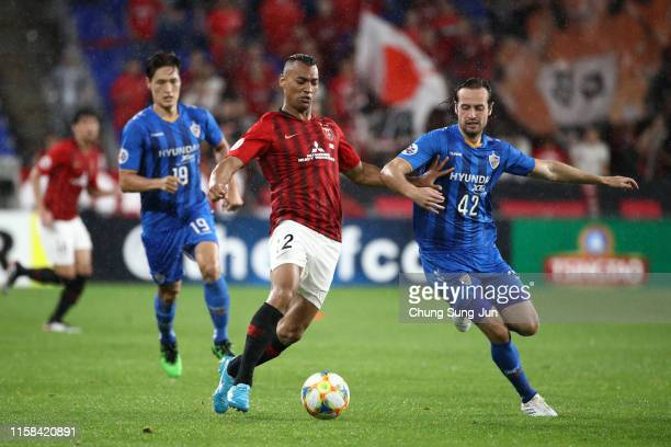 Fabricio of Urawa Red Diamonds takes on Mix Diskerud of Ulsan Hyundai during the AFC Champions League round of 16 second leg match between Ulsan...