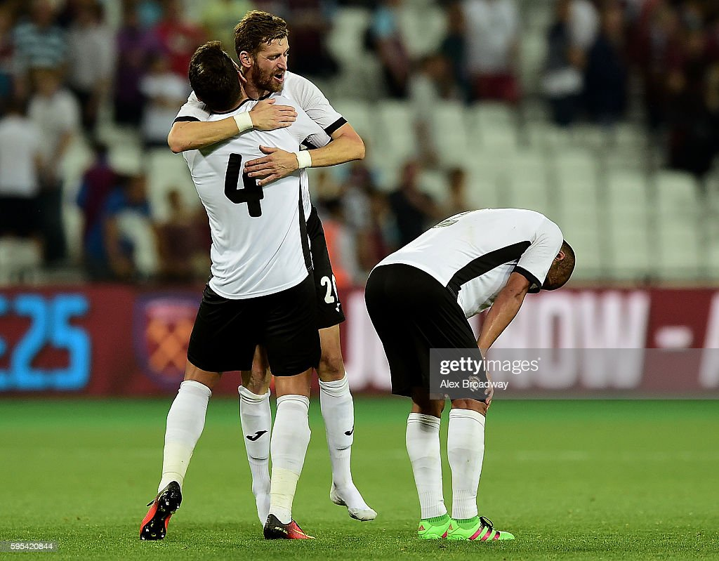 Fabricio Silva Dornellas and Florin Lovin of FC Astra Giurgiu celebrate following the UEFA Europa League match between West Ham United and FC Astra Giurgiu at the Olympic Stadium on August 27, 2016 in London, England.