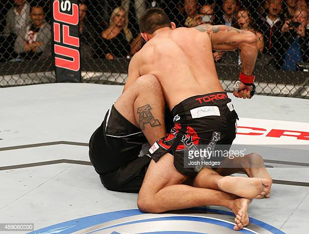 Fabricio Werdum finishes Mark Hunt by TKO after knocking him down with a knee in their interim UFC heavyweight championship bout during the UFC 180...