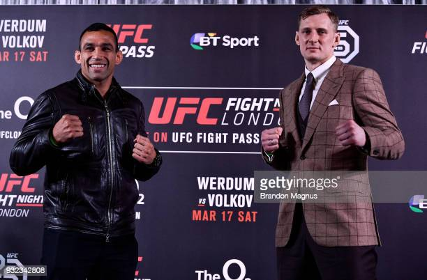 Fabricio Werdum of Brazil and Alexander Volkov of Russia pose for the media during the UFC Fight Night Ultimate Media Day in Glaziers Hall on March...