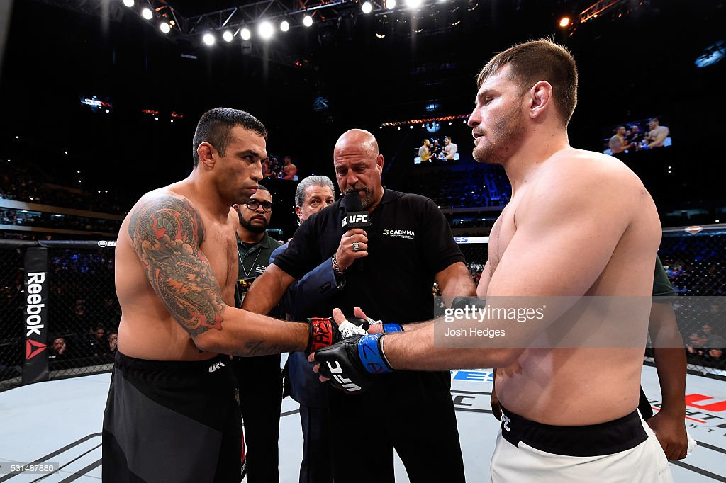 Fabricio Werdum of Brazil and Stipe Miocic touch gloves before their UFC heavyweight championship bout during the UFC 198 event at Arena da Baixada stadium on May 14, 2016 in Curitiba, Parana, Brazil.