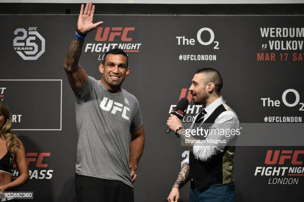 Fabricio Werdum of Brazil is interviewed by UFC commentator Dan Hardy poses on the scale during the UFC Fight Night weighin inside The O2 Arena on...