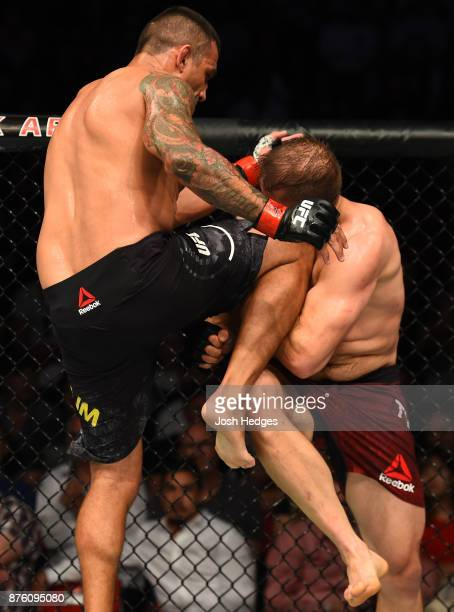 Fabricio Werdum of Brazil knees Marcin Tybura of Poland in their heavyweight bout during the UFC Fight Night event inside the Qudos Bank Arena on...