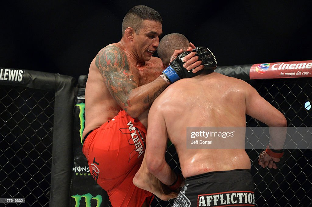 Fabricio Werdum of Brazil lands a knee to the chin of Cain Velasquez of the United States in their UFC heavyweight championship bout during the UFC 188 event inside the Arena Ciudad de Mexico on June 13, 2015 in Mexico City, Mexico.