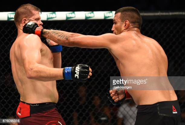 Fabricio Werdum of Brazil punches Marcin Tybura of Poland in their heavyweight bout during the UFC Fight Night event inside the Qudos Bank Arena on...