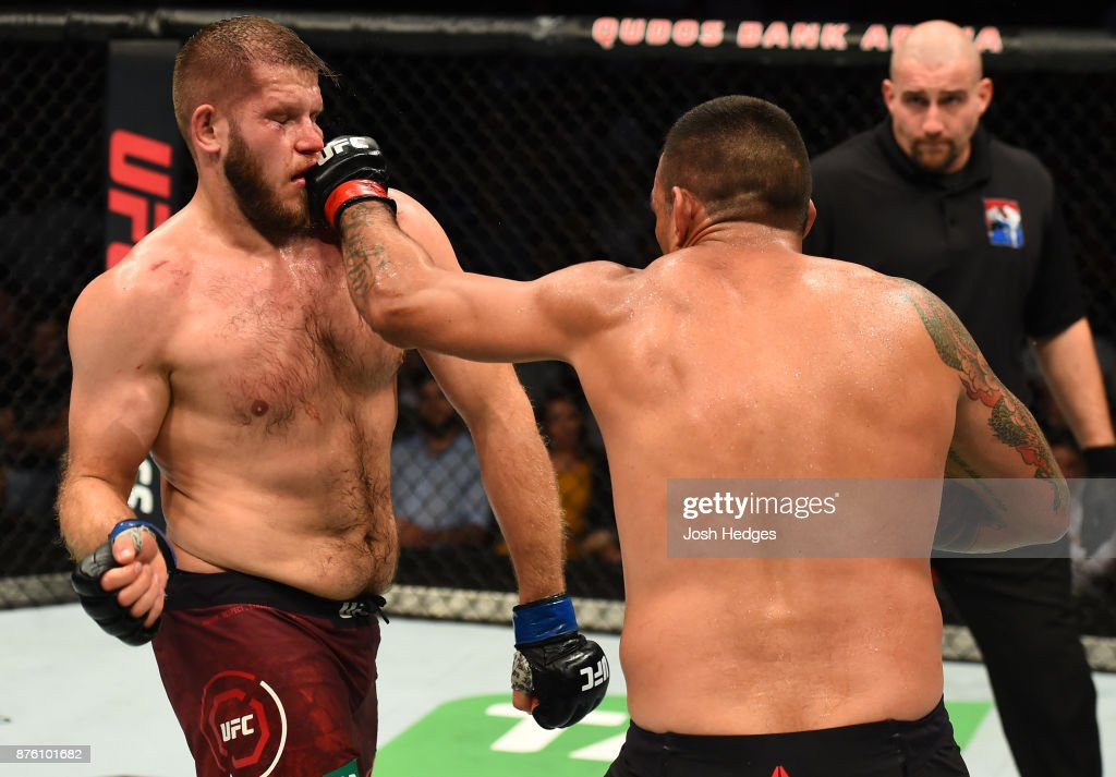 Fabricio Werdum of Brazil punches Marcin Tybura of Poland in their heavyweight bout during the UFC Fight Night event inside the Qudos Bank Arena on November 19, 2017 in Sydney, Australia.