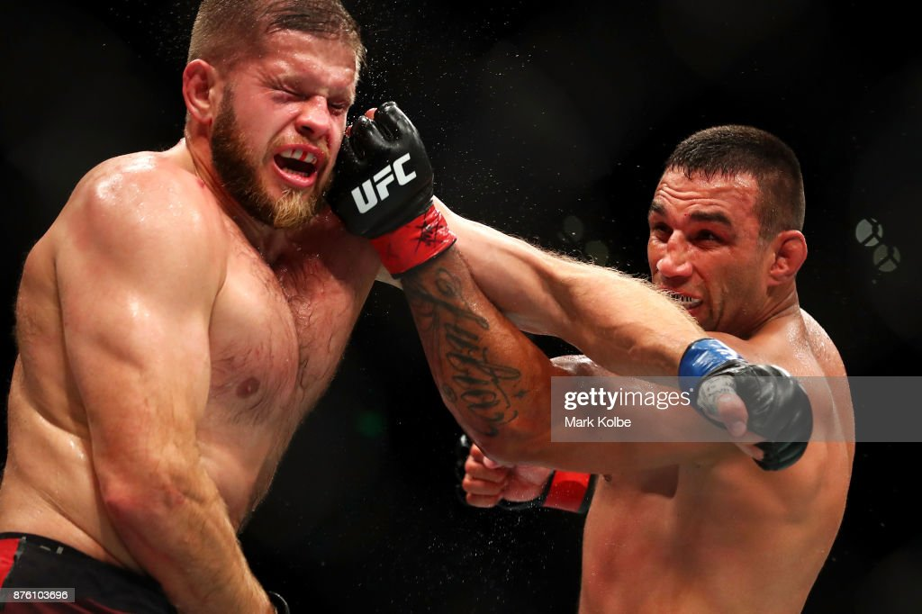 Fabricio Werdum (R) of Brazil punches Marcin Tybura of Poland in their heavyweight bout during the UFC Fight Night at Qudos Bank Arena on November 19, 2017 in Sydney, Australia.