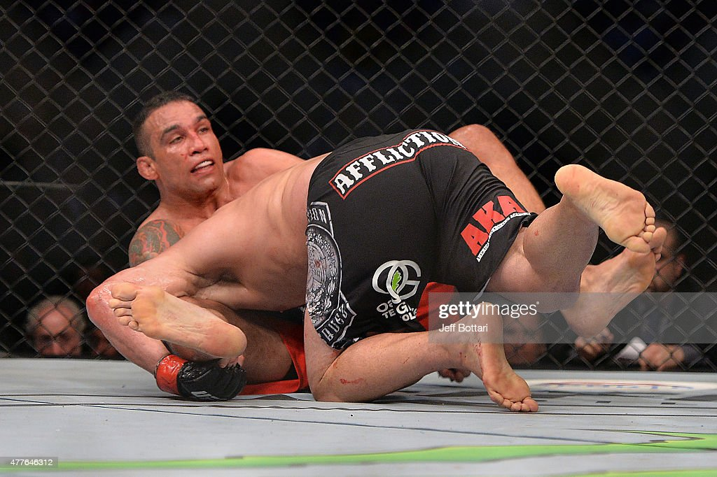 Fabricio Werdum of Brazil secures a guillotine choke against Cain Velasquez of the United States in their UFC heavyweight championship bout during the UFC 188 event inside the Arena Ciudad de Mexico on June 13, 2015 in Mexico City, Mexico.