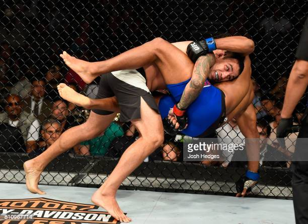 Fabricio Werdum of Brazil takes down Alistair Overeem of the Netherlands in their heavyweight bout during the UFC 213 event at TMobile Arena on July...