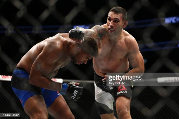 Fabricio Werdum punches Alistair Overeem during the UFC 213 event at TMobile Arena on July 9 2017 in Las Vegas Nevada