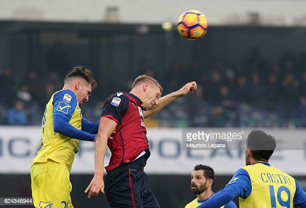 Fabrizio Cacciatore of Chievo competes for the ball in the air with Bartosz Salamon of Cagliari during the Serie A match between AC ChievoVerona and...