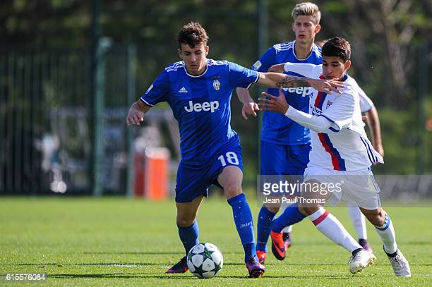 Fabrizio CALIGARA of Juventus and Houssem AOUAR of Lyon during the Youth League match between Lyon and Juventus at Plaine des Jeux de Gerland on...