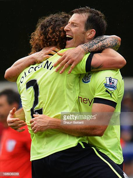 Fabrizio Coloccini and Mike Williamson of Newcastle United celebrate as they avoid relegation after the Barclays Premier League match between Queens...