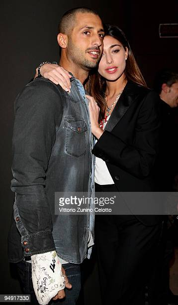 Fabrizio Corona and Belen Rodriguez attend the Isaia Christmas Cocktail Party on December 19 2009 in Milan Italy
