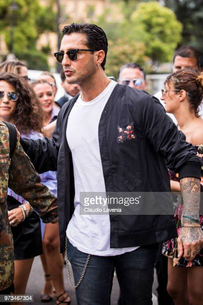 Fabrizio Corona wearing white tshirt and blue jacket is seen during the 94th Pitti Immagine Uomo at Fortezza Da Basso on June 13 2018 in Florence...