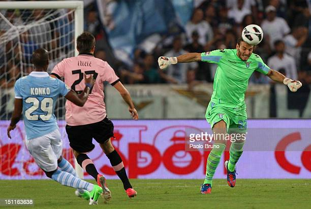 Fabrizio Marchetti the goalkeeper of SS Lazio in action as his teammate Abdoulay Konko and Josip Ilicic of US Citta' di Palermo looks on during the...