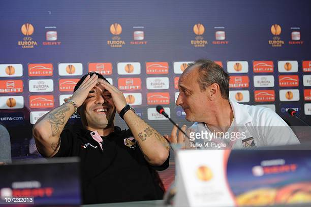 Fabrizio Miccoli captain of Palermo smiles as coach Delio Rossi looks on during the press conference ahead of the UEFA Europa League Group F match...