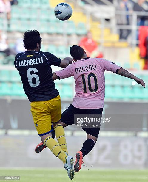 Fabrizio Miccoli of Palermo and Alessandro Lucarelli of Parma jump for a header during the Serie A match between US Citta di Palermo and Parma FC at...