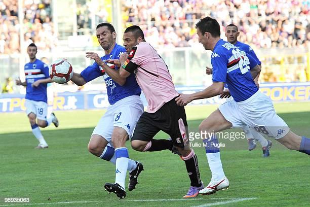 Fabrizio Miccoli of Palermo and Luciano Zauri and Daniele Gastaldello of Sampdoria compete for the ball during the Serie A match between US Citta di...