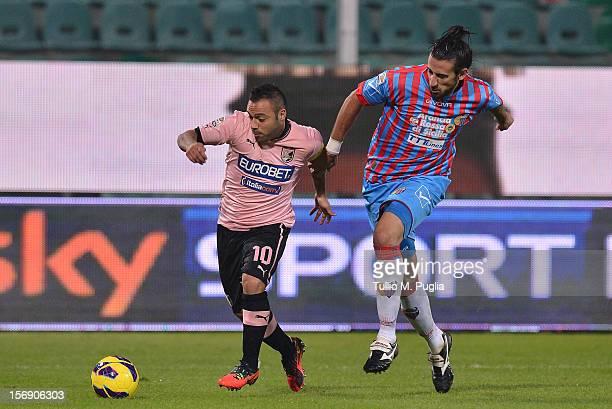 Fabrizio Miccoli of Palermo and Nicolas Spolli of Catania compete for the ball during the Serie A match between US Citta di Palermo and Calcio...