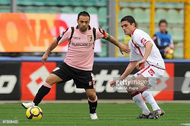 Fabrizio Miccoli of Palermo and Romano Perticone of Livorno compete for the ball during the Serie A match between US Citta di Palermo and AS Livorno...