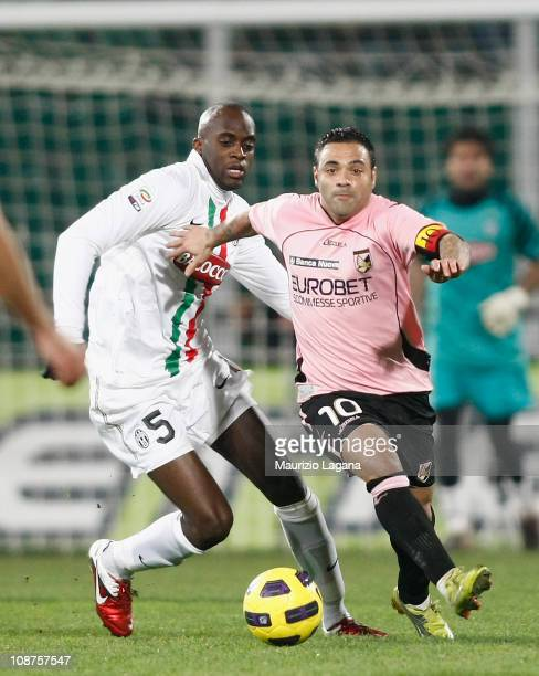 Fabrizio Miccoli of Palermo battles for the ball with Mohamed Sissoko of Juventus during the Serie A match between US Citta di Palermo and Juventus...