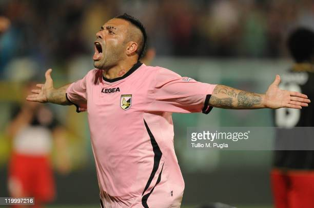 Fabrizio Miccoli of Palermo celebrates after scoring the second equalizing goal during the Europa League third qualifying round between US Citta di...