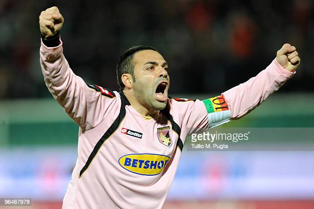 Fabrizio Miccoli of Palermo celebrates Fabio Simplicio's goal during the Serie A match between Palermo and Parma at Stadio Renzo Barbera on February...