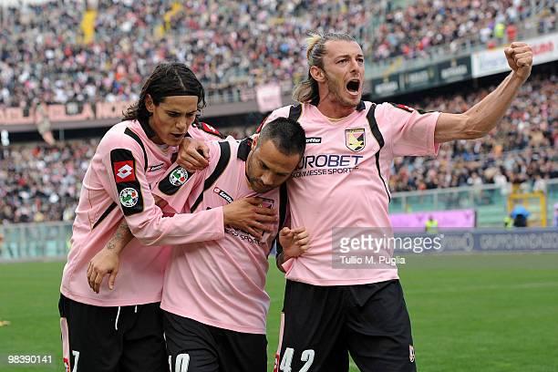Fabrizio Miccoli of Palermo celebrates his goal with his team-mates Edinson Cavani and Federico Balzaretti during the Serie A match between US Citta...