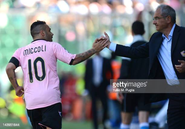 Fabrizio Miccoli of Palermo celebrates with Coach Bortolo Mutti after scoring a penalty during the Serie A match between US Citta di Palermo and AC...
