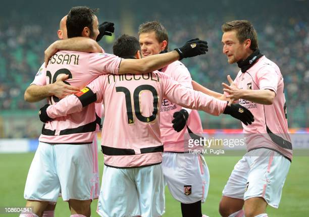Fabrizio Miccoli of Palermo celebrates with team mates after scoring the opening goal during the Serie A match between FC Internazionale Milano and...